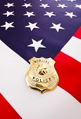 picture of police  - Police badge on american flag Concept us law enforcement - JPG