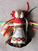 pic of adornment  - Ukrainian handmade folk doll. Traditional fabric adornment.