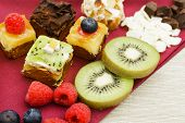 image of petition  - Assortment of petit four desserts Sweet food and desserts - JPG