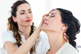 picture of hypnotic  - Therapist hypnotizing her patient on white background - JPG