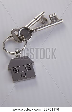 House shaped key chain with keys