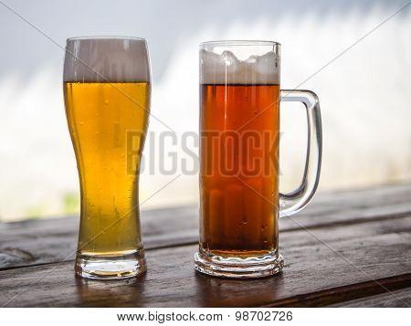 Beer mug and glass with light or dark drinks