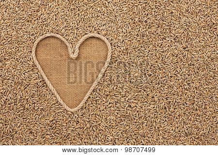 The Symbolic Heart Made Of Rope Lies On Sackcloth And Rye Grains