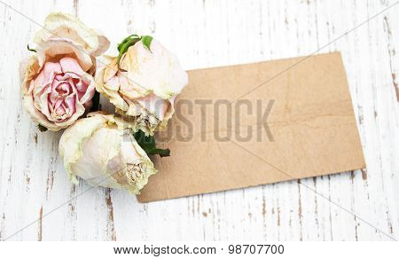 Old Paper With Dried Roses