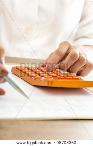 Woman Using A Manual Calculator