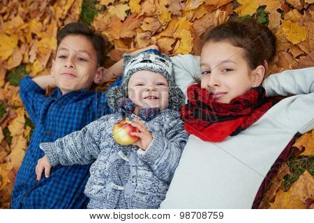 boys and girl in autumn park