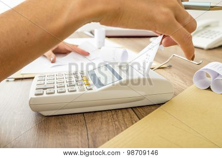 Bookkeeper Doing Calculations On An Adding Machine