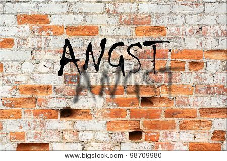 Angst sign on decaying brick wall