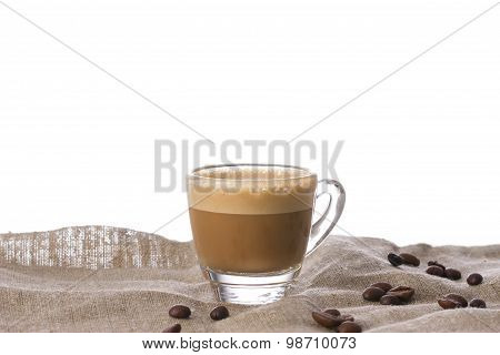 Cappuccino With Crema In Transparent Cup On Sacking