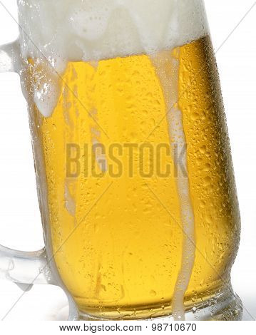 Mug Of Beer With Foam Dripping