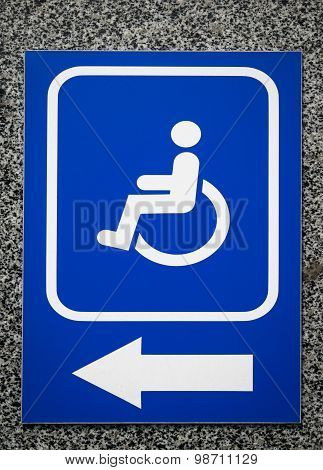 The sign Parking Space or Building entrance with ramp for Disabled People on marble