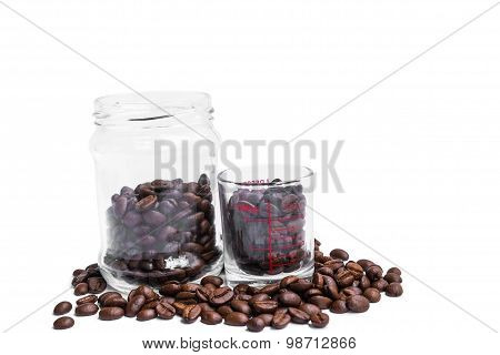 roasted coffee beans, coffee shot glass and glass jar