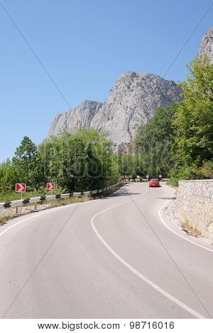 Landscape with the image of a mountain road