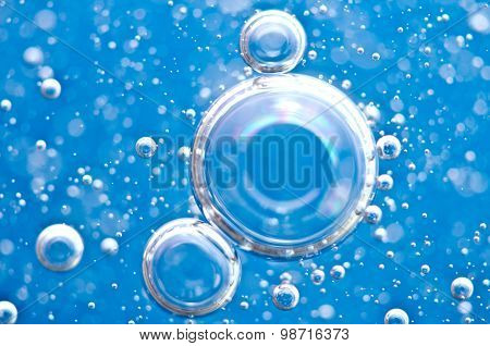 Macro Oxygen Bubbles In Blue Clear Water