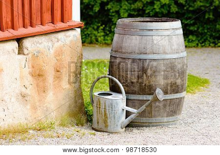 Wooden Barrel And Watering Can