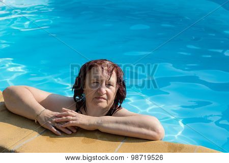 Active Senior Woman In A Swimming Pool