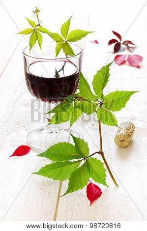 Glass Of Red Wine And Grape Leaves