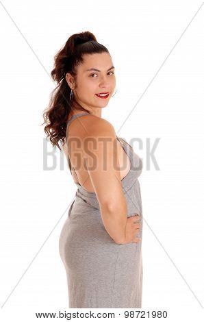 Beautiful Woman In Gray Dress In Profile.