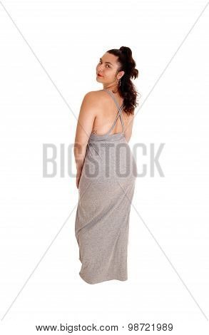 Beautiful Woman In Gray Dress From The Back.