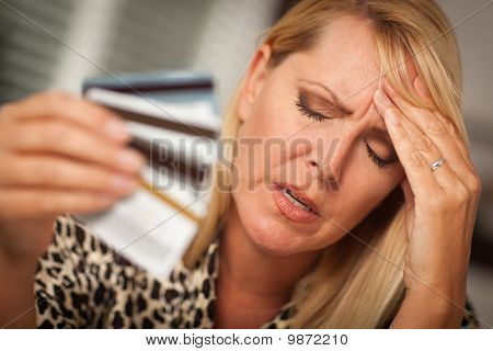 Upset Woman Holding Her Many Credit Cards