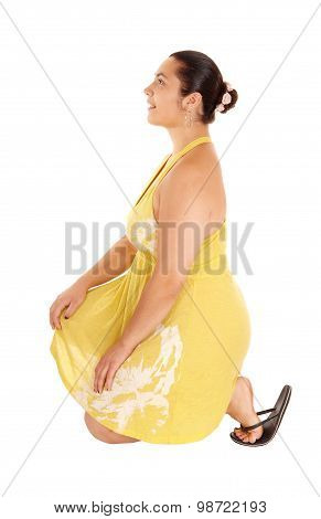 Pretty Woman In Yellow Dress Kneeling.