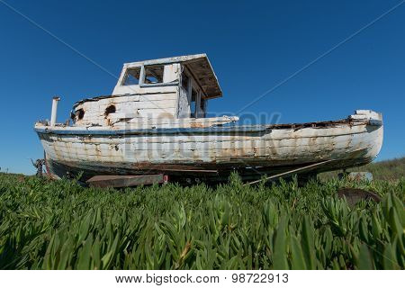 Old Wooden Boat With Paint Peeling Everywhere