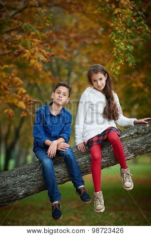 boy and girl in autumn park