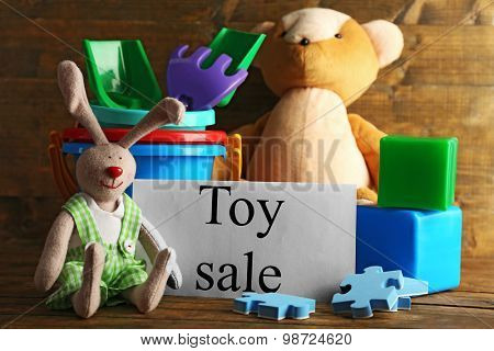 Toys for sale on wooden background