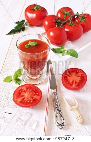 Bunch Of Tomatoes And Tomato Juice