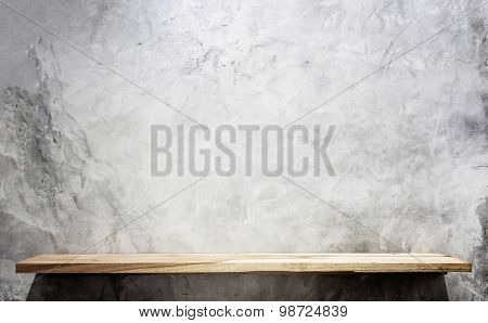 Empty Top Wooden Shelves And Stone Wall Background