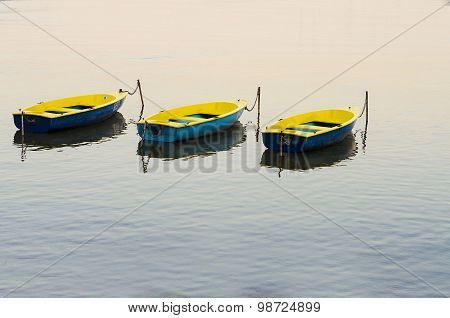 Three colorful boats on the colorful water