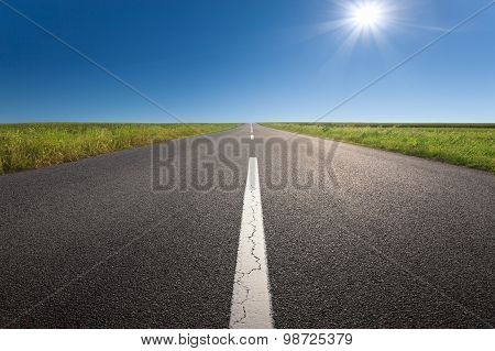 Driving On An Empty Asphalt Road At Idyllic Sunny Day