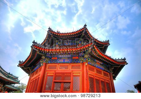 Typical red tower of a chinese temple under the strong sun Beijing