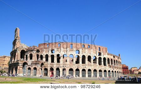 Tourists visiting the Colosseum (Coliseum) in Rome Italy on a clear sky