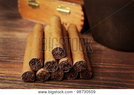 Cigars on wooden table, closeup