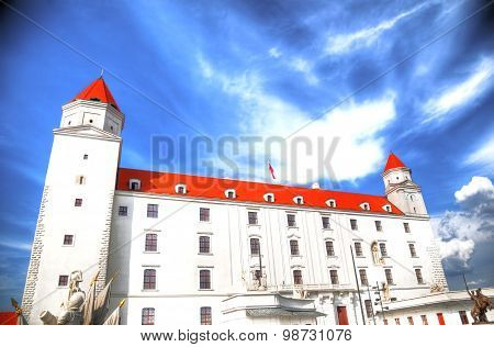 Artistic image of Bratislava castle on a cloudy blue sky in High dynamic range (HDR) Slovakia
