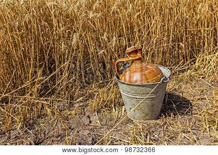 Ceramic Amphora Is Protected With Metal Bucket.