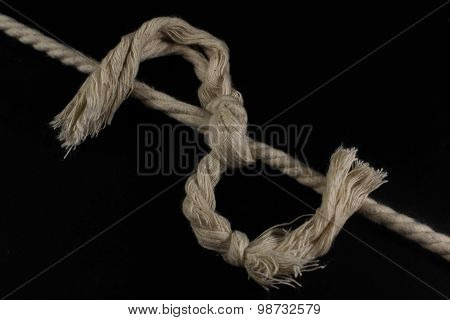 Rope Tied Together In A Frayed Knot