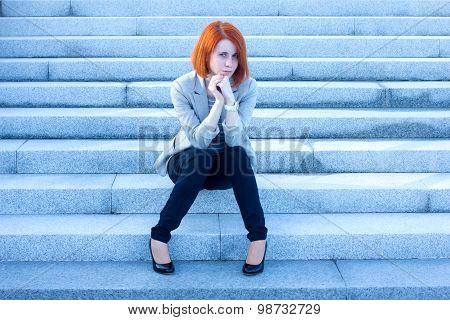 Very Sad Woman Sitting Outside And Waiting For Someone