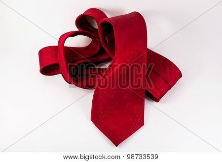 Crumpled Red Silk Tie On White Horizontal Background
