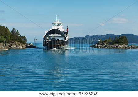 Ferry boatz arrives to the port in Tveit, Norway.