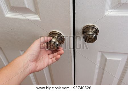 Hand opening the door close up