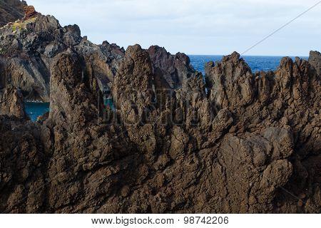 Volcanic Lava Cliffs In Porto Moniz, Madeira Island