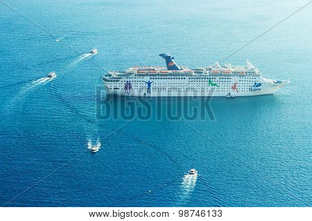 Cruise Ship Disembarking In Santorini