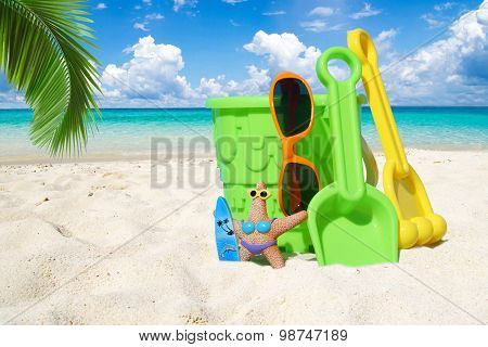 Colorful Beach Toys Under Palm Frond