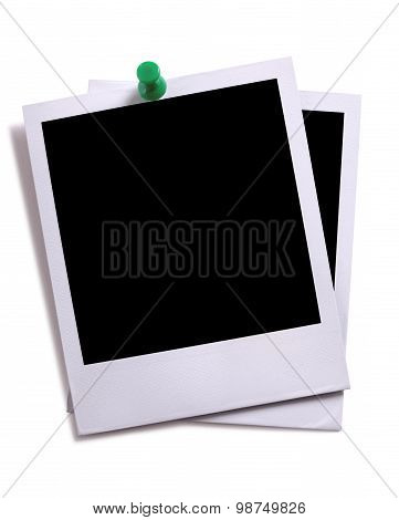 Two Blank Instant Camera Photo Prints With Green Pushpin Isolated On White With Shadow.