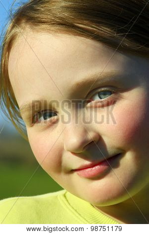 Portrait Of Little Beautiful Girl With Blue Eyes