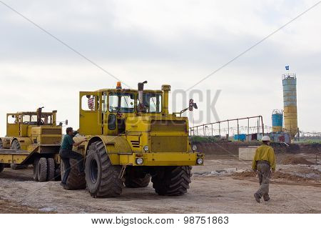 Krasnoarmeysk, Ukraine - October 18 2012: Tractor Driver And Construction Worker At A Construction S