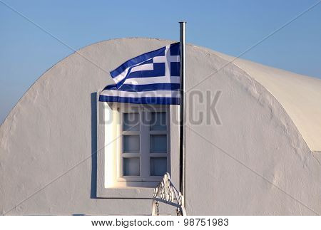 Greece Flag On Sunset Light In Oia, Santorini Island.