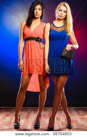 Two Elegant Women In Dresses.